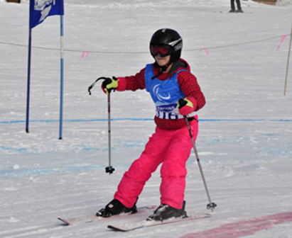 Young girl skier in pink